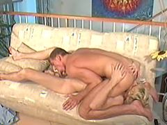 Young gay cocklovers enjoy 69 pose on the sofa