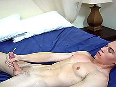 A fresh young guy working out, playing with his huge cock...