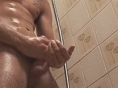Pretty dude jerks off his stiff cock in the shower