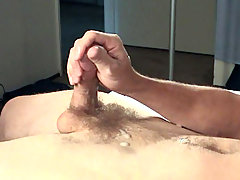 Tommy entertains himself with porno and stroke his hard dick